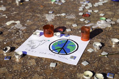 World peace symbol drawn on paper on the ground with candles Royalty Free Stock Photography