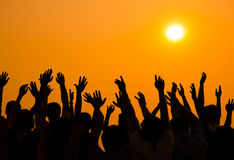 World People Celebrating During Sunset Stock Image
