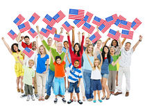 World People Holding American Flag. Cheerful Multi-Ethnic Group Of People Standing With Their Arms Raised Holding American Flag Stock Image