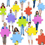 World People Holding Jigsaw Pieces Royalty Free Stock Image