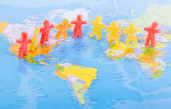 World people peace concept. Colorful jelly candy people placed on a world map, in a world peace concept Stock Photo