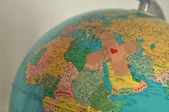 World with plaster with heart - Solidarity and aid to countries. In need concept Stock Image