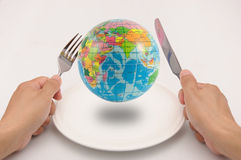 The world on plate. Waiting for dinner royalty free stock image