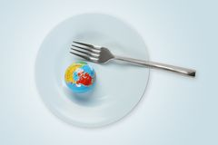 World in a plate with fork Royalty Free Stock Photo