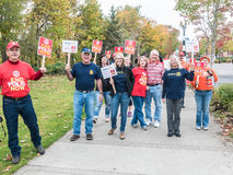 World Polio Day marchers pause to pose for photo in Corvallis, O. Corvallis, Oregon, October 24, 2015: World Polio Day marchers with signs pause to smile for Royalty Free Stock Photos