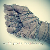 World press freedom day. The text world press freedom day and the hand of a man completely tied with wire, depicting the idea of oppression or repression Royalty Free Stock Photo