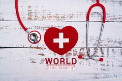 World Red Cross day. Red heart with Stethoscope on wooden table background stock image