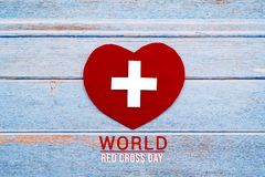 World Red Cross day. Red heart on wooden table background texture stock photo