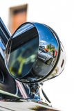 World in a reflection. Mirror of ford vintage mustang Royalty Free Stock Images