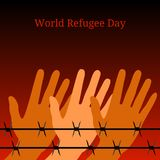World Refugee Day. Hands behind barbed wire. Background symbolizes a fire at night. World Refugee Day. Concept of social event. 20 June. Hands behind barbed wire Royalty Free Stock Photo