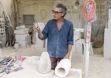 World-renowned limestone artist Renzo Buttazo lecturing to tour group in his studio. Pictured is world-renowned limestone artist Renzo Buttazo lecturing to a Royalty Free Stock Image
