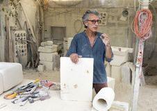World-renowned limestone artist Renzo Buttazo lecturing to tour group in his studio. Pictured is world-renowned limestone artist Renzo Buttazo lecturing to a Royalty Free Stock Photo