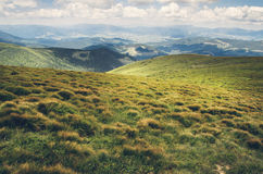 The World at Rest. Beautiful mountain landscape. Beautiful mountain landscape from the top of the mountain Hoverla, Ukraine. Green grass, clouds and perspective Royalty Free Stock Photography