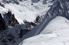 A world of rock and ice. The telefre glacier on the mt blanc. In the background the droites Stock Photography