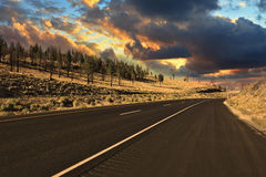 The world's best American road to sunset. The world's best American road. The magnificent sunset over the steppe Royalty Free Stock Photo