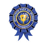 World`s best dad ever - French printable award ribbon. Best Dad in the World French language: - blue shiny award ribbon  label with champions cup. Print colors Stock Image