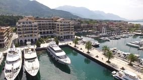 World`s best marine for super yachts boats . Porto Montenegro in Tivat. World`s best marine for super yachts boats. Porto Montenegro in Tivat, Montenegro, Aerial stock video footage