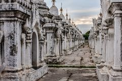 The World`s Biggest Book, Mandalay, Myanmar. Stone tablets inscribed with the Tripiá¹­aka stand upright in the grounds of the Kuthodaw Pagoda at the royalty free stock photo