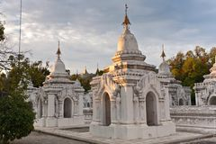 The World`s Biggest Book, Mandalay, Myanmar. Stone tablets inscribed with the Tripiá¹­aka stand upright in the grounds of the Kuthodaw Pagoda at the royalty free stock image