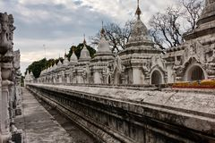 The World`s Biggest Book, Mandalay, Myanmar. Stone tablets inscribed with the Tripiá¹­aka stand upright in the grounds of the Kuthodaw Pagoda at the foot of stock photos