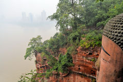 World's biggest Buddha with Leshan skyline Royalty Free Stock Photos