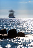 The world`s largest sailing ship leaves at sunset in the open sea Royalty Free Stock Images