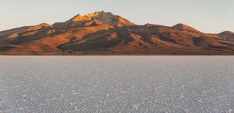 The world`s largest salt flat, Salar de Uyuni in Bolivia, photographed at sunrise Stock Photo