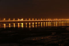 The longest bridge in the world in night. Sunset, two rows of lighted on the bridge, the reflection in the water Stock Photography
