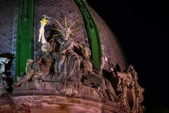 The world`s only sitting Statue of Liberty at night time. Lviv woman Liberty gently embraces two men. Ukraine, Lviv, 1891 royalty free stock photography