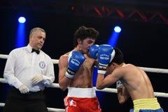 World series of boxing: Ukraine Otamans vs British Lionhearts. Kyiv, UKRAINE - January 23, 2014 : Andrew Selby (UK) and Azat Usenaliev (UA) in the ring during stock photos
