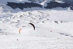 World snowkite contest Altosangro 2016. Roccaraso, Italy - January 31, 2016: Snowkiter in action at world championship Stock Photos