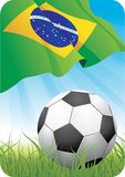 World soccer championship 2010 - Brazil. 2010 championship Cup theme with a classic ball on the grass and Brazilian flag Stock Photo