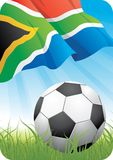 World soccer championship 2010 - South Africa. 2010 Soccer championship theme with a classic ball on the grass and South African flag Royalty Free Stock Photo