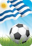 World soccer championship 2010 - Uruguay. 2010 Soccer championship theme with a classic ball on the grass and Uruguayan flag Royalty Free Stock Photography