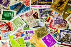 World Stamps. Stamps from around the world in a pile Royalty Free Stock Photo