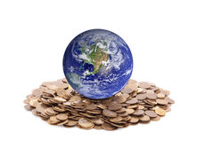 World standing on money. Stock Photos
