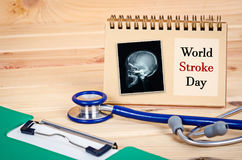 World Stroke Day. World Stroke Day and  x ray of skull or head human with stethoscope medical and document file Royalty Free Stock Image