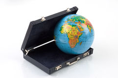 The world in a suitcase. The globe coming out of a siutcase stock photography