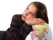 World Support. Young girl leaning against the world stock photos