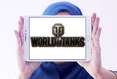 World of Tanks game logo. Logo of World of Tanks game on samsung tablet holded by arab muslim woman. World of Tanks WoT is a massively multiplayer online game stock images