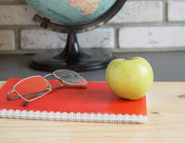 World teachers Day in school. Still life with books, globe, Apple, glasses selective focus Stock Image