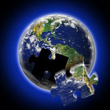 World teamwork. An image for the concept of teamwork using the image of the earth with a puzzle piece missing. Showing an image of the whole world with a piece Royalty Free Stock Image