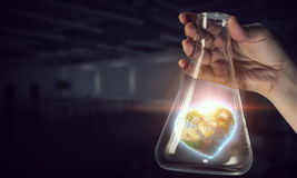 The world in test tube . Mixed media Royalty Free Stock Photo