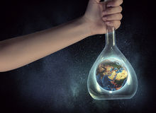 The world in test tube . Mixed media Royalty Free Stock Image