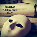 World theater day, with a retro effect. The text world theater day and a mask and an old scroll, with a retro effect Royalty Free Stock Photos