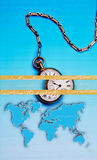 World Time, Abstract Business Art. World and time, abstract business art. Vertical photo of pocket watch and chain and world map royalty free stock photography