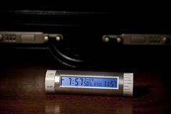 World Time traveller. World Time Clock on desk with briefcase Royalty Free Stock Photography