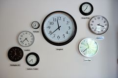World time zone clocks. Installed on the wall Royalty Free Stock Photo