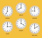 World time zones. Wall clocks showing local times. World time zones. Clocks displaying time in big cities Royalty Free Stock Photo