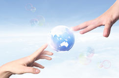 World to hand. Bubble world on sky to  you Stock Image